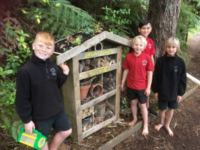 The recently completed Bug Hotel and the architects/builders!